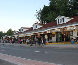 row of shops on beach road in lake george