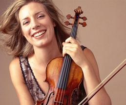 a woman smiling with her violin