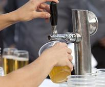 beer being poured into a cup from a tap