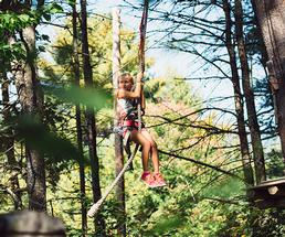 girl on an aerial adventure course