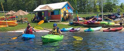 two people in rental kayaks