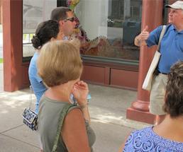man talking to audience on a walking tour