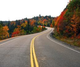 road through fall foliage mountains