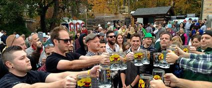 festival attendees raising steins