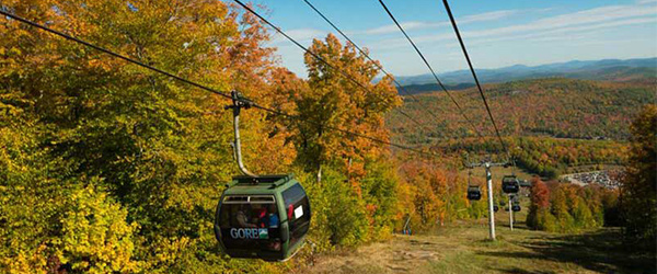 gore mountain gondola with fall colored trees