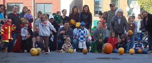kids rolling pumpkins