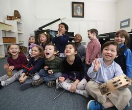 a group of little kids with instruments