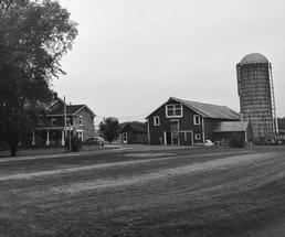 black and white image of a farm