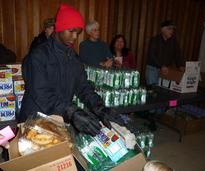 kid sorting donated food items