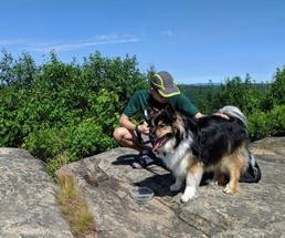 man with dog on summit
