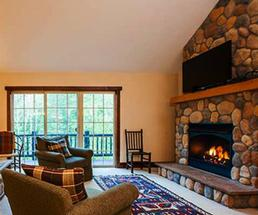 a fireplace and plush chairs at owaissa club vacation rentals