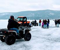 atv and people on frozen lake