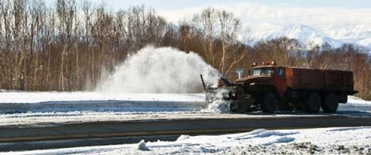 snow plow on the road