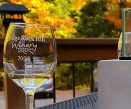 wine glass against fall backdrop