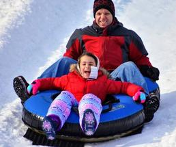 parent and kid snow tubing