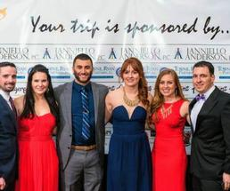 group of people posing at a gala