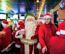 Santa and group at bar