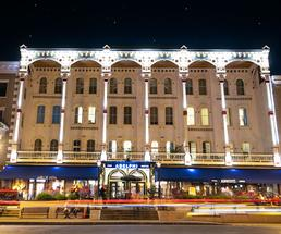 the outside of the Adelphi at night