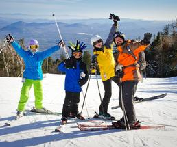 skiers on a mountain top