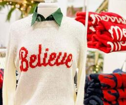 sweater that says believe