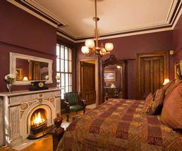 a fireplace in a guestroom at the mansion inn