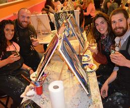 four people doing a paint and sip