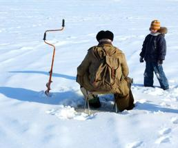 man and kid ice fishing