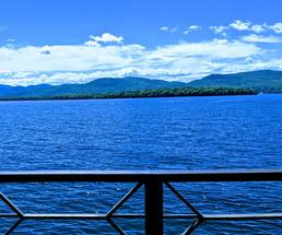 view of lake and mountains from deck