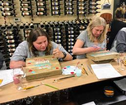 women at wine and painting event