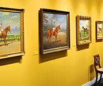 horse racing paintings on a wall