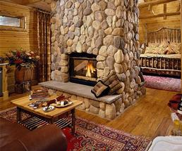 room with a fireplace in an inn