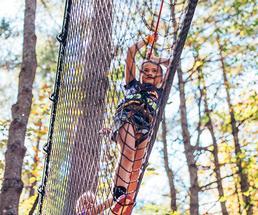 girl climbing a cargo net