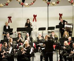 lake george community band performing on stage