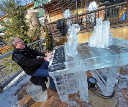 man playing an ice piano