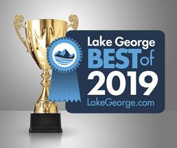 trophy with 2019 best of lake george badge
