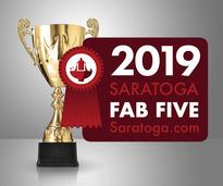 fountain in saratoga with fab five badge