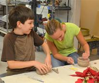 two kids making things out of clay