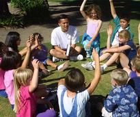 kids sitting in a circle at summer camp