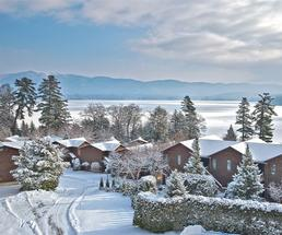 view of lake george and cabins in winter