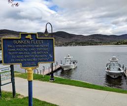 Sunken Fleet sign by boats