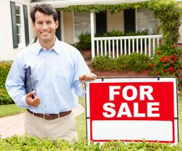realtor with for sale sign