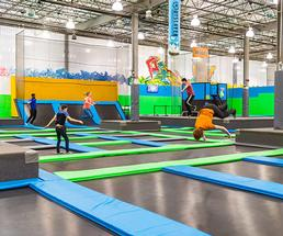people in an indoor trampoline park