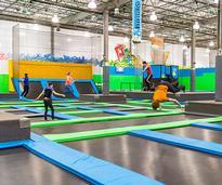 people in an indoor trampoline park