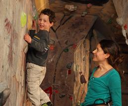 boy on an indoor rock wall