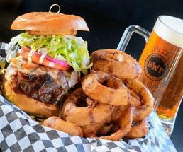 huge burger, onion rings, beer mug