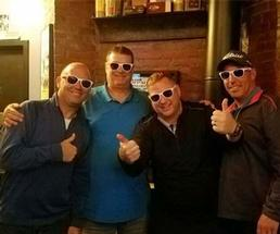 four men wearing sunglasses