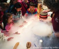 kids watching a science experiment