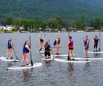 women on stand up paddleboards