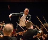 conductor conducting orchestra