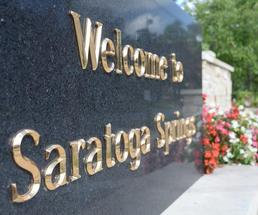 base of native son statue that says welcome to saratoga springs